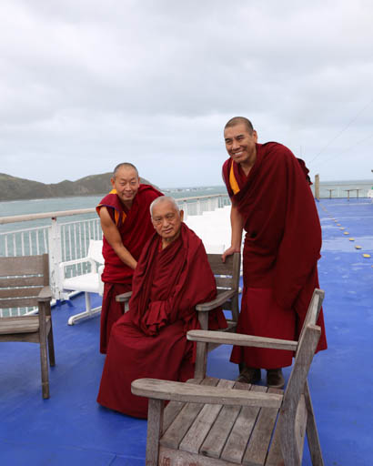 Lama Zopa Rinpoche, Geshe Thubten Wangchen and Geshe Jampa Tharchin on ferry boat to North Island, New Zealand, May 2015. Photo by Ven. Thubten Kunsang.
