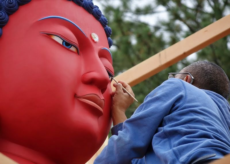 Gelek Sherpa opening the buddha statue's eyes at Buddha Amitabha Pure Land, Washington, US, August 2014. Photo by Ven. Roger Kunsang.