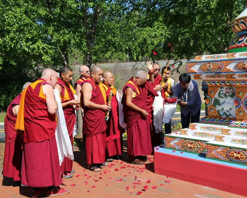 Lama Zopa Rinpoche blessing the Kadampa stupa at Kadampa Center, Raleigh, North Carolina, US, May 3, 2014. Photo by Ven. Thubten Kunsang.