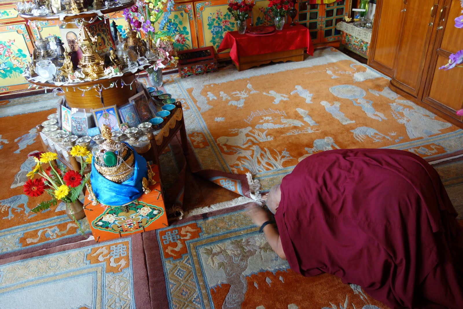 First thing in the morning, Rinpoche is doing prostrations to the altar in his room. There is one altar that has many holy relics on it and Rinpoche circumambulates it every day. Rinpoche is making a very quick stop here on the way to Mongolia. Aug 10, 2013.