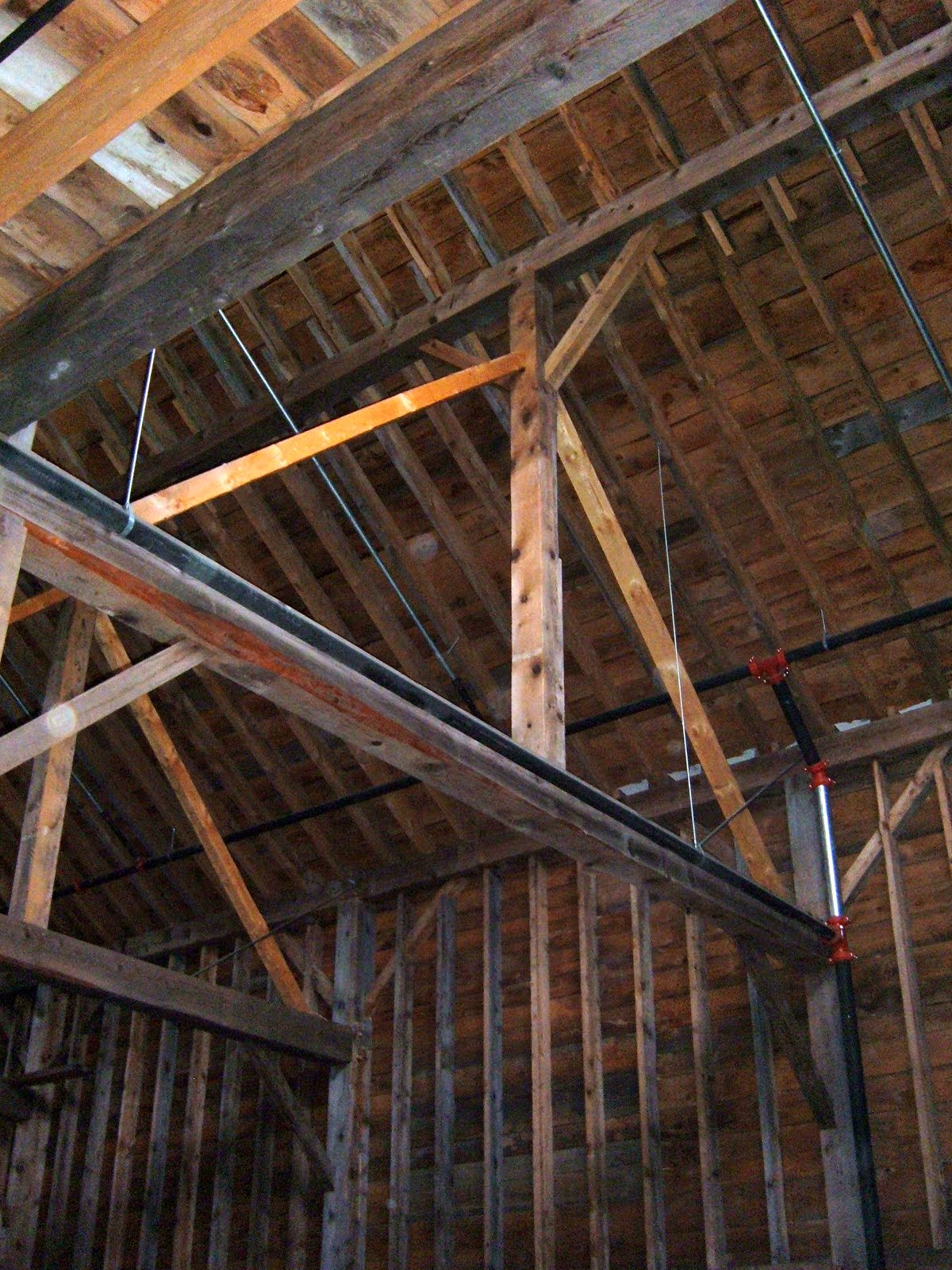 Purlin post are supported by two braces making it a king post truss.Which helps stop the tie beam from deflecting from the roof load.