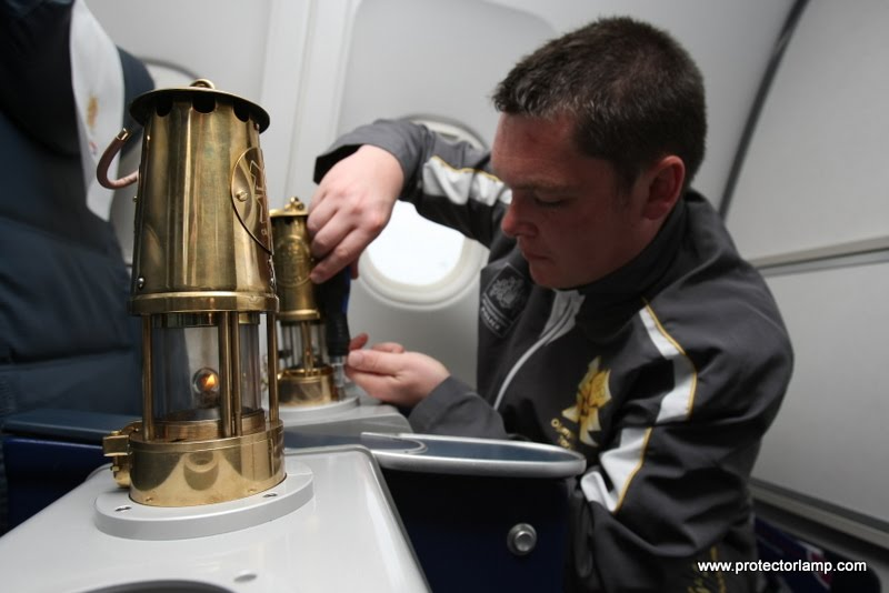 Inspector Andy Marriner from the Metropolitan police secures the olympic flame into seat 1a and 1b for the flight back to the UK.