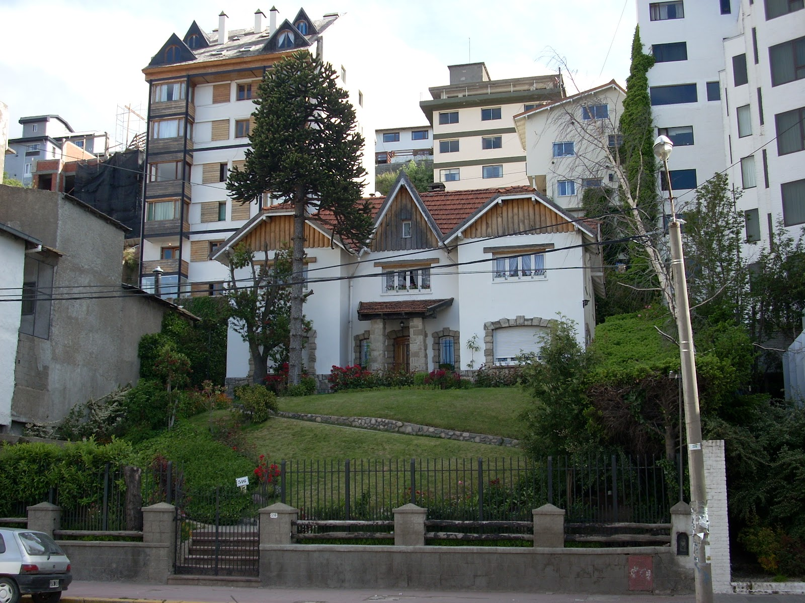 I like this house, nestled amongst the bland modern buildings