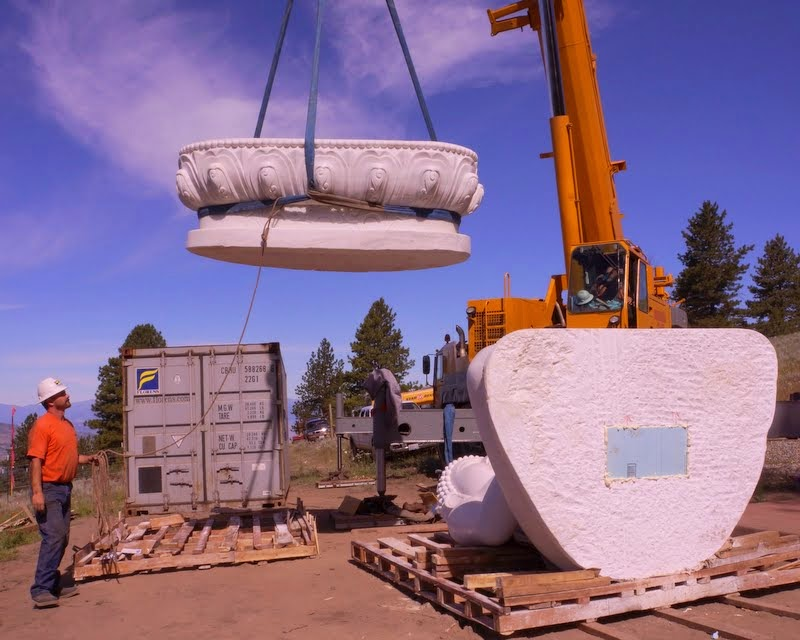 Moving the carved white marble lotus throne on to the base, Buddha Amitabha Pure Land, Washington, US, July 1, 2014. Photo by Merry Colony.