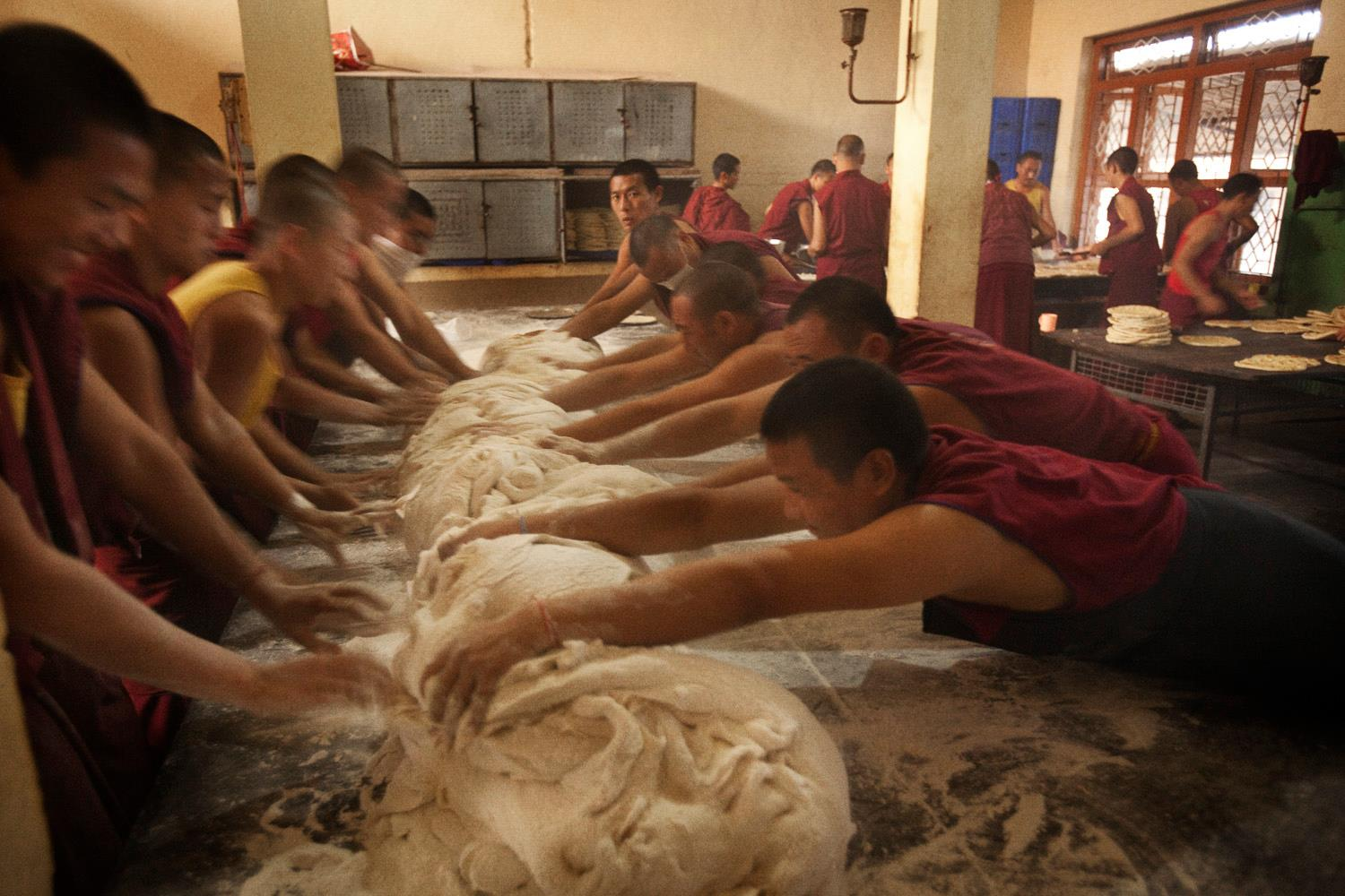 Monks working together to make the bread for all the Sangha