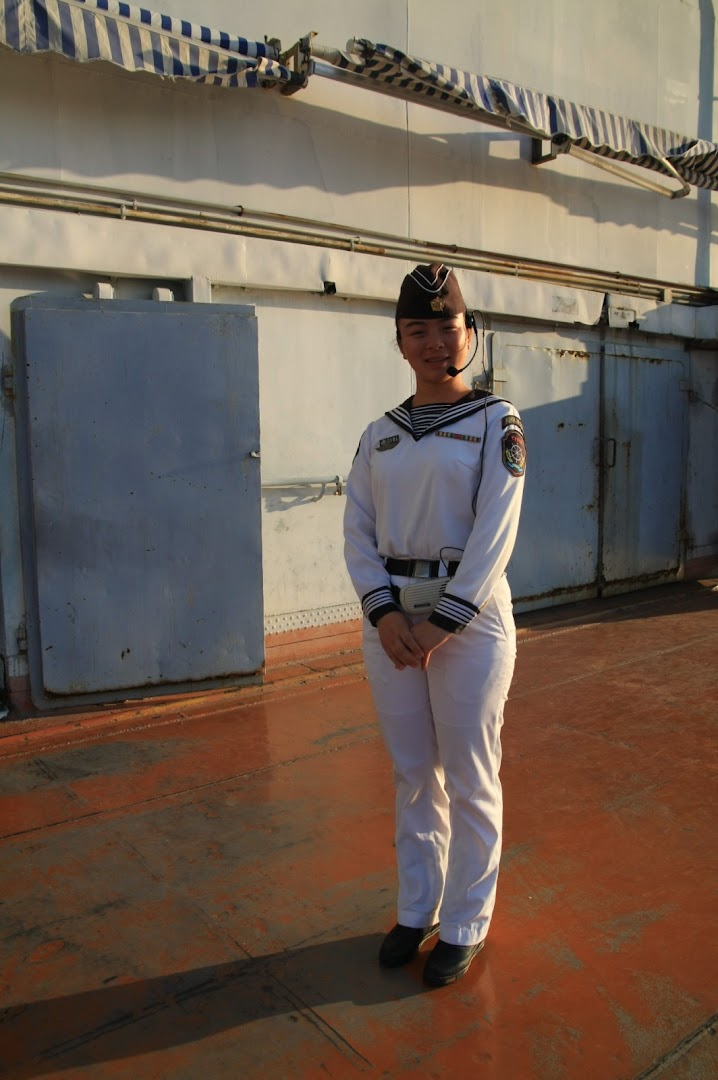 A friendly Chinese girl, pretending to be serving in military