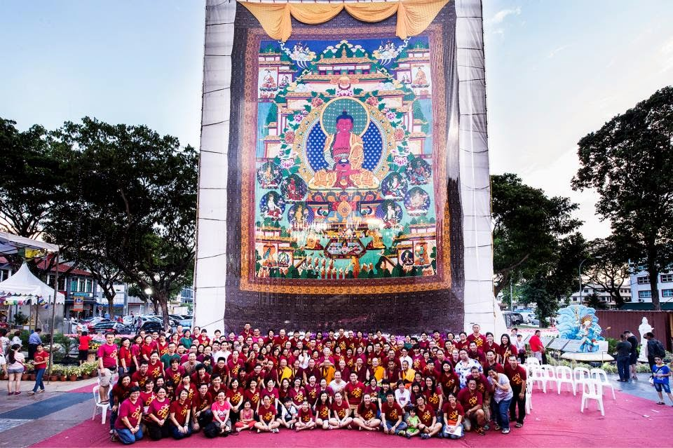 Amitabha Buddhist Centre, Singapore. This thangka is 50 feet high and 30 feet wide and portrays Amitabha Buddha in His Pure Land accompanied by the eight great bodhisattvas.