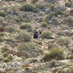 Desert zombies out in the middle of nowhere. We had no idea who they were, military, minutemen, Mexican immigrants? All we know  is they were dressed in black and seemed surprised to see us.