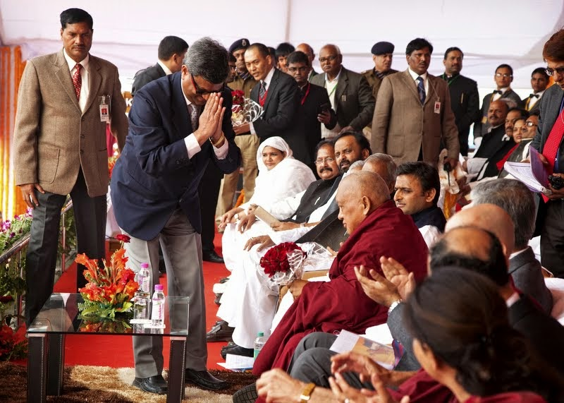 Lama Zopa Rinpoche with dignataries on event stage, Kushinagar, India, December 13, 2013. Photo by Andy Melnic.