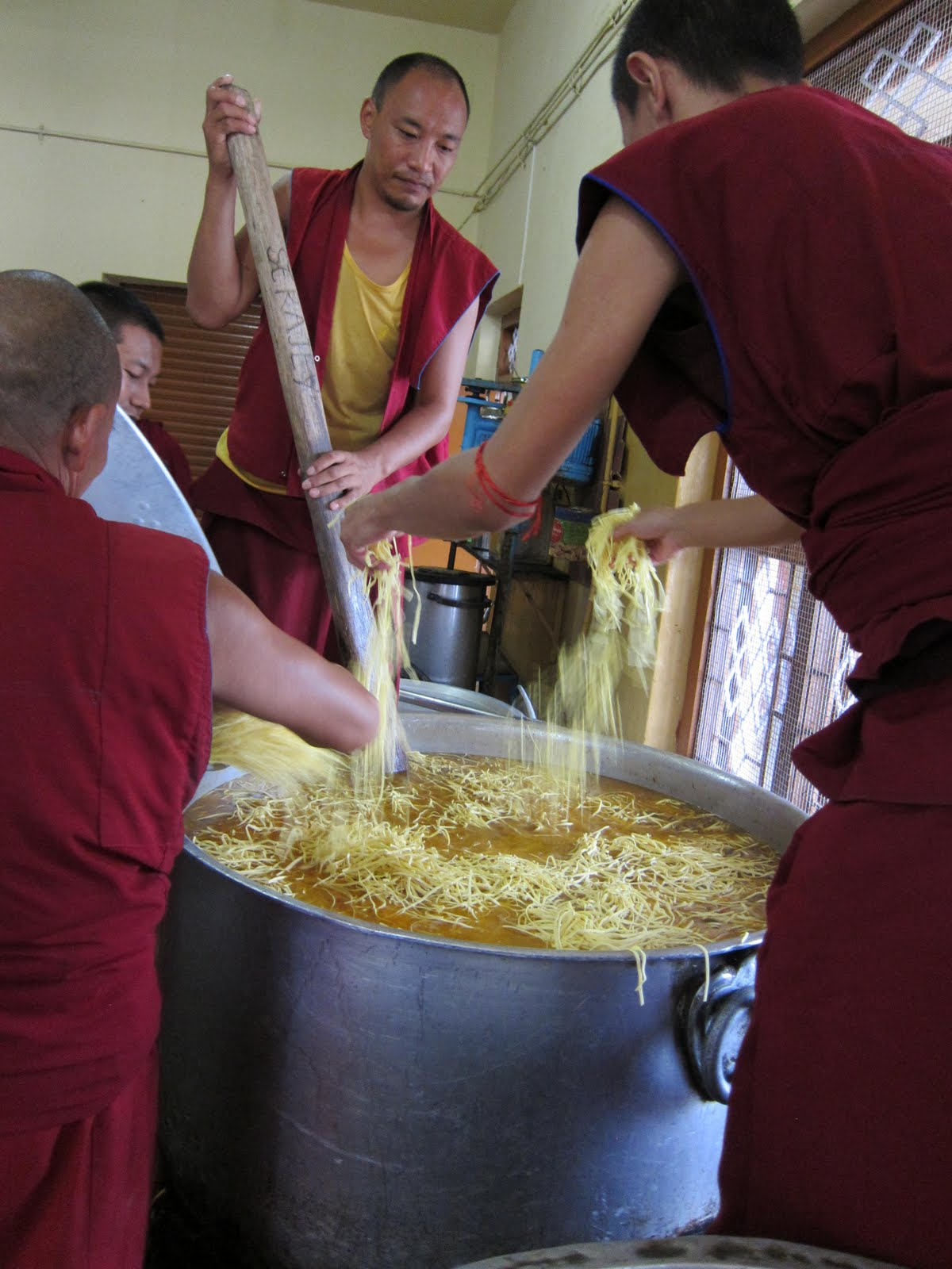Cooking giant pots of pasta soup