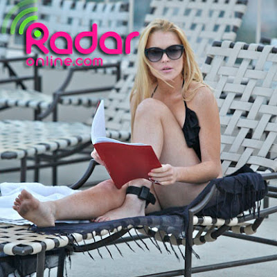 Lindsay spent the afternoon with sister Ali and a friend by a pool in Hollywood CA_ Lindsay looked very relaxed sunbathing and reading what looked like to be a script to her sister and friend_ Lindsay chose to hide away from the media as it was said today that her Scram bracelet indicated that she had drank alcohol at an after party for the MTV movie awards last Sunday.AKM Images  06_08_10   Premium Exclusive_   Internet CALL for fee.Alex 310 3478241.alex_akmimages.net