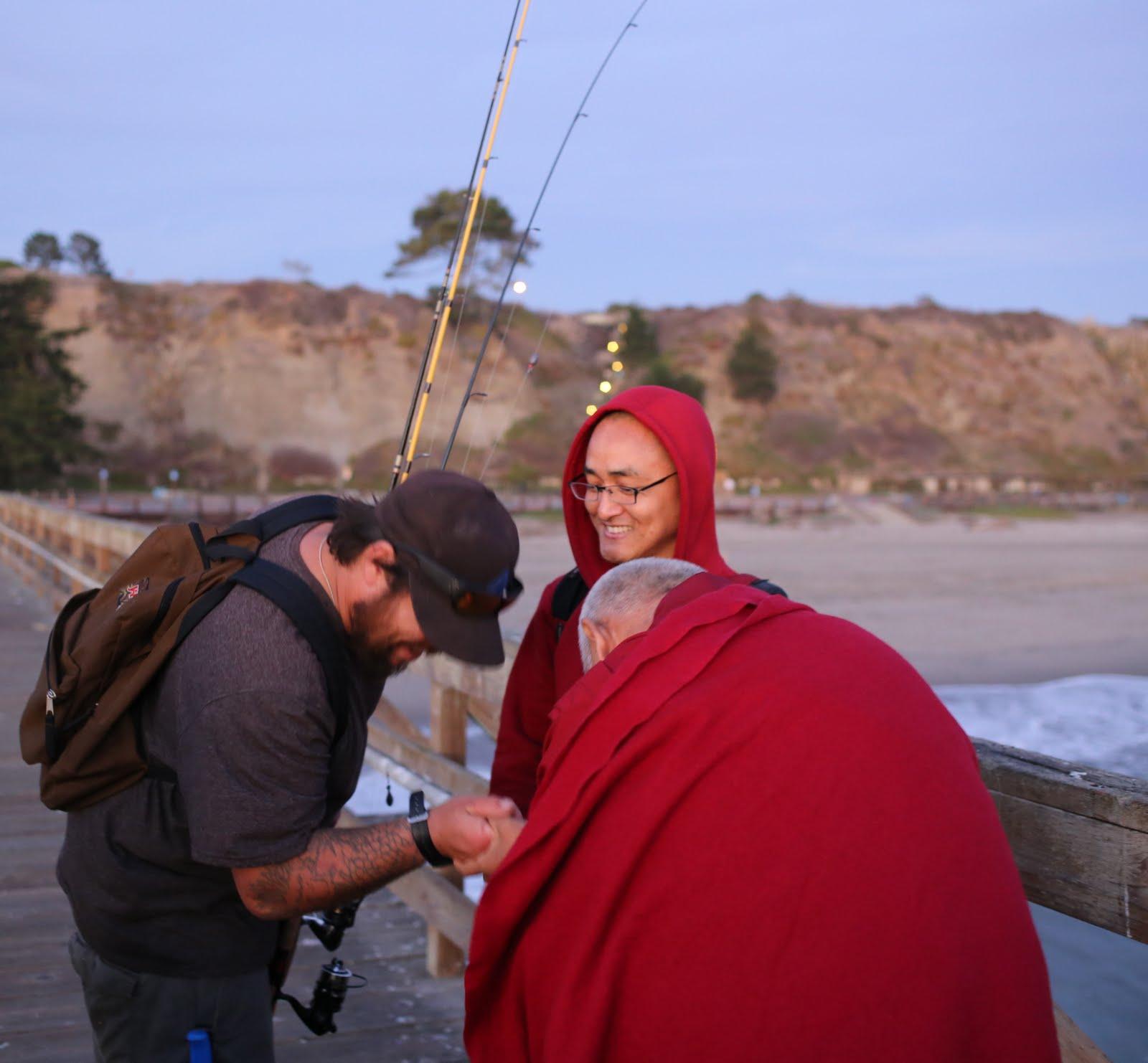 Lama Zopa Rinpoche and fisherman, California, November 2013. Photo by Ven. Thubten Kunsang.