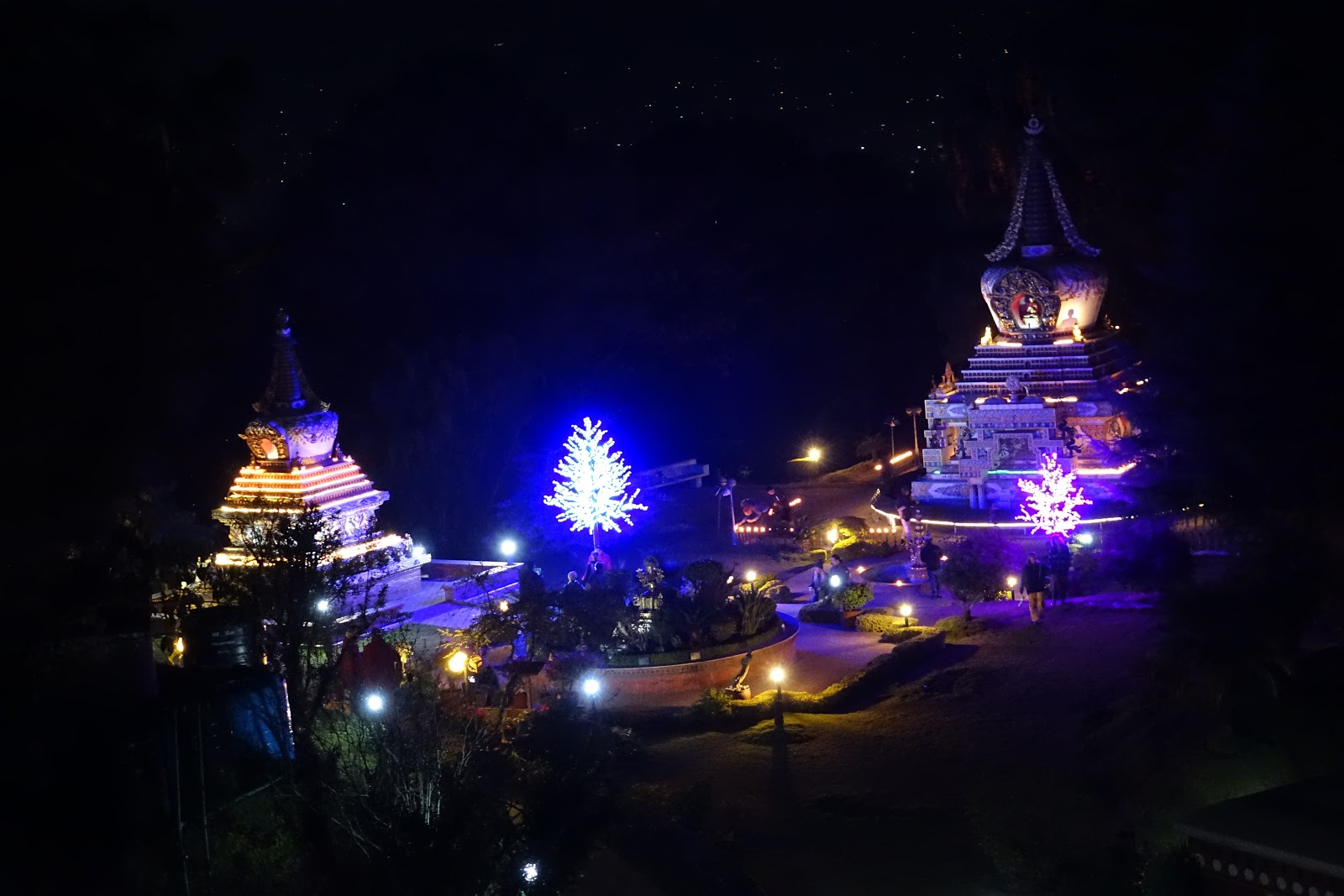 Kopan Monastery at Night, Khensur Rinpoche Lama Lhundrup's stupa to the left and Geshe Lama Konchog's stupa to the right and new light offerings on the trees, Nepal, December 2014. Photo by Ven. Roger Kunsang.