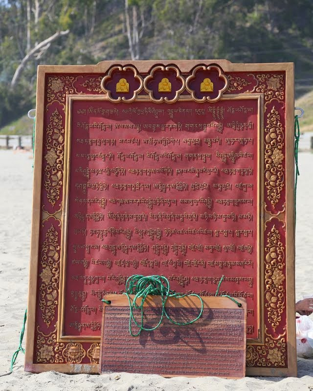 Namgyälma mantra boards on beach, California, US, May 2014. Photo by Ven. Thubten Kunsang.