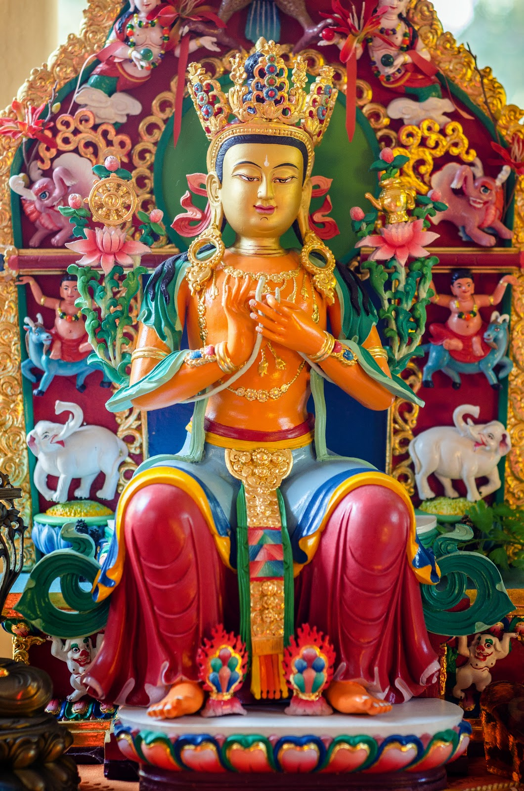 Maitreya statue and extensive offerings at Kachoe Dechen Ling. Photo by Chris Majors.