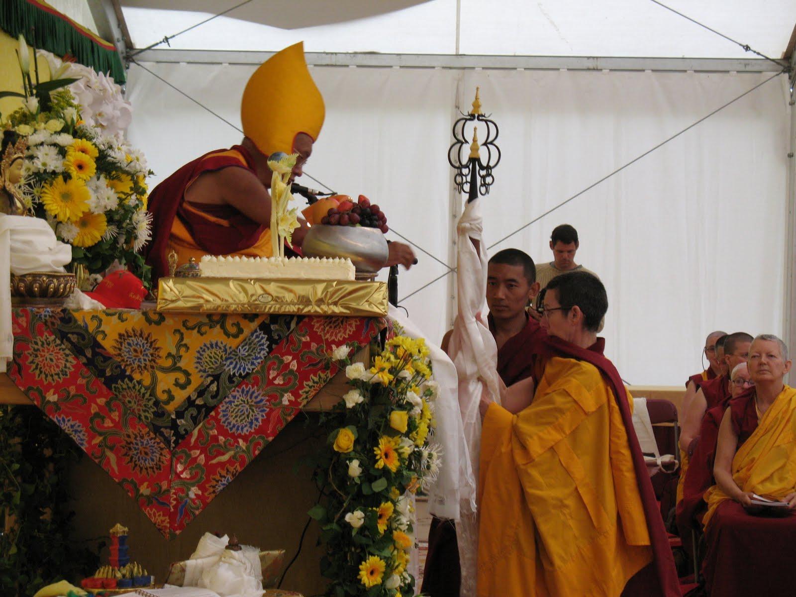 Ven. Kaye Miner offering monks staff during longLifepujaofferedtoLamaZopaRinpocheaftertheCPMTMeetingatInstitutVajraYogini,France, May2009.