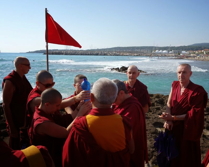 Lama Zopa Rinpoche with Sangha at the beach doing offerings to pretas, Italy, June 2014. Photo by Ven. Roger Kunsang.