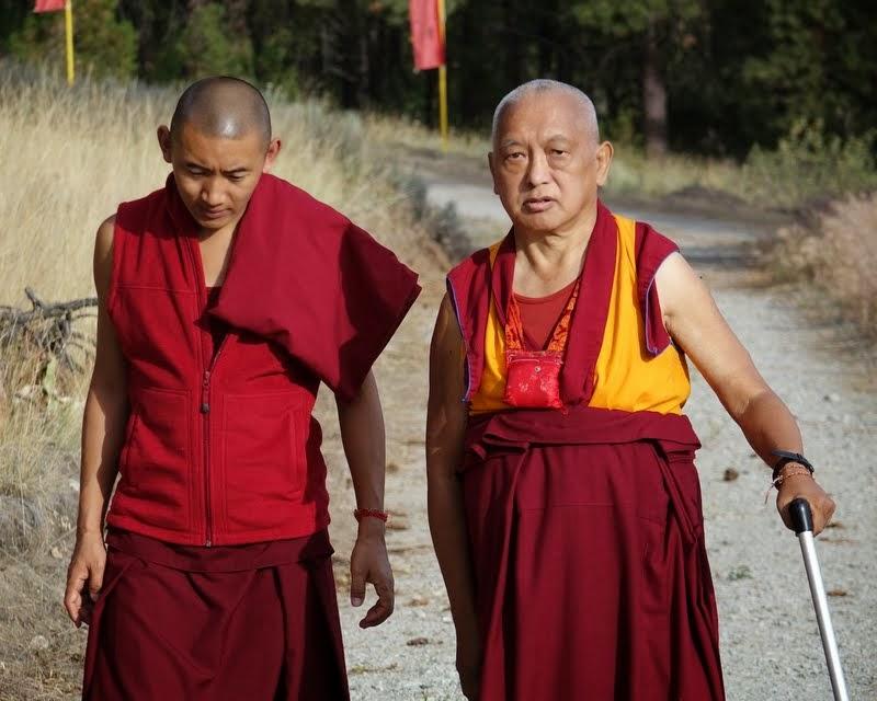 Lama Zopa Rinopche and Ven. Sangpo walk up to see the new Amitabha Buddha statue at Buddha Amitabha Pure Land, Washington, US, July 2014. Photo by Ven. Roger Kunsang.