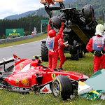 Crashed Ferrari of Kimi Raikkoenen and McLaren of Fernando Alonso