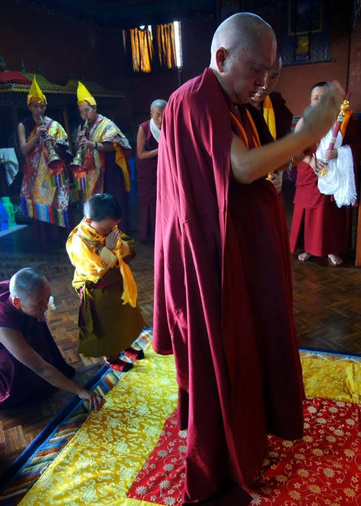Lama Zopa Rinpoche and the young lama do prostrations in the nunnery gompa, Kathmandu, Nepal, November 22, 2013. Photo by Ven. Roger Kunsang.