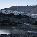 The glacier looks dirty because of the black lava sand