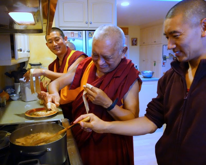 Lama Zopa Rinpoche making tukpa for Tenzin Ösel Hita with Vens. Tsering and Sangpo, Kachoe Dechen Ling, Aptos, California, May 2014. Photo by Ven. Roger Kunsang.