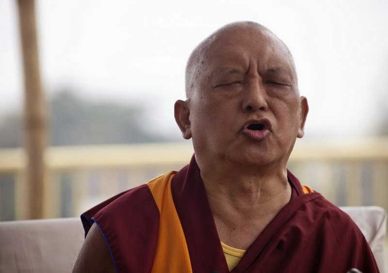 Lama Zopa Rinpoche during a Padmasambhava incense puja on the roof of Root Institute, Bodhgaya, India, March 2014. Photo by Andy Melnic.