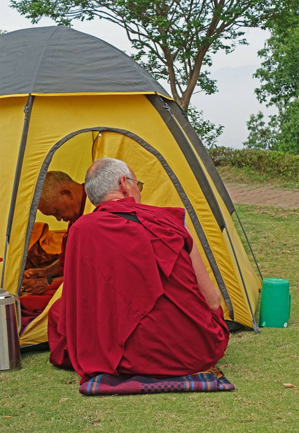 FPMT Spiritual Director Lama Zopa Rinpoche and CEO Ven. Roger Kunsang, where they camped days after the first earthquake, Kopan Monastery, April 2015