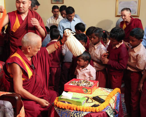 Lama Zopa Rinpoche blessing the students at Maitreya School and the children from Tara Children's Project, Bodhgaya, India, March 2015. Photo by Ven. Roger Kunsang.