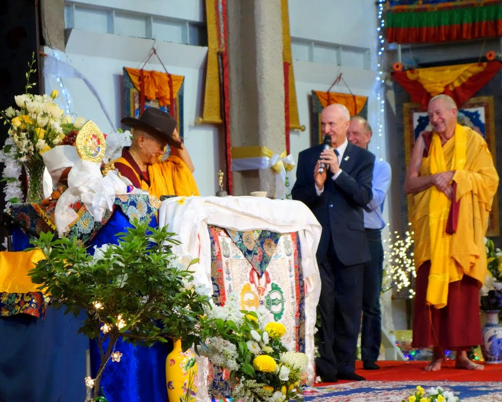 Ian Green, director of Great Stupa of Universal Compassion, offering Lama Zopa Rinpoche an iconic Akubra hat during the long life puja, Australia, October 23, 2014. Photo by Ven. Roger Kunsang.