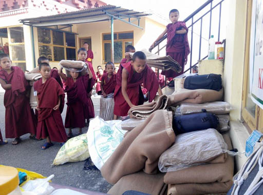 Even the young monks contribute blankets for those affected by the earthquake, Kopan Monastery, Nepal, May 2015. Photo by Geshe Thubten JInpa.