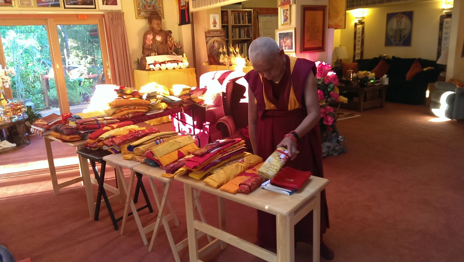 """Rinpoche sorting through his texts. Ven. Roger Kunsang explains, """"All of these we carry in four big heavy suitcases everywhere we go!"""" Sep 13,  2013 Photo: Ven. Roger Kunsang"""