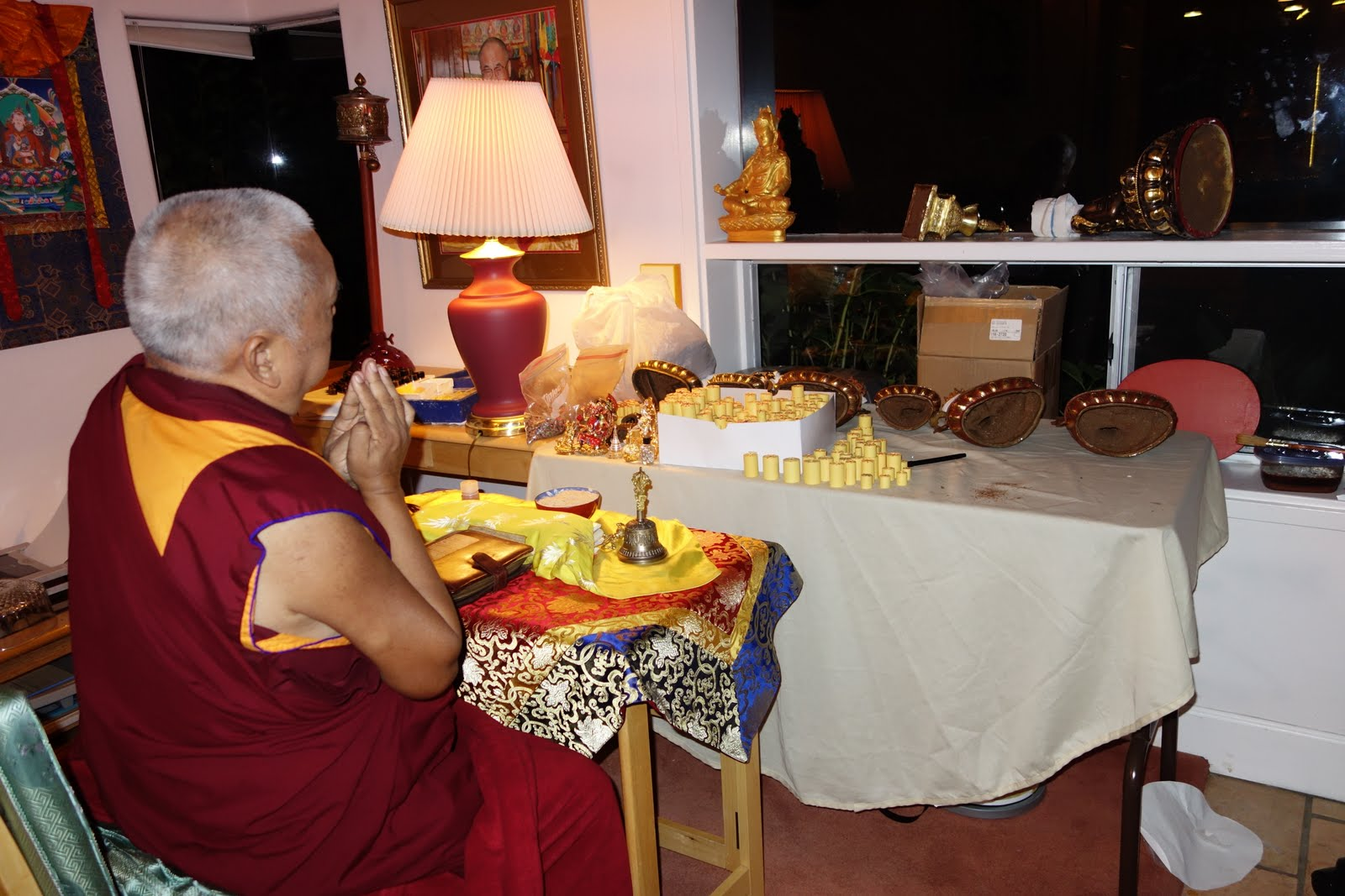 Rinpoche blessing mantras to go into statues just after lunch (which happened at 7: 30pm) Dinner will be around midnight or after! Oct 21, 2013. Photo by Ven. Roger Kunsang.
