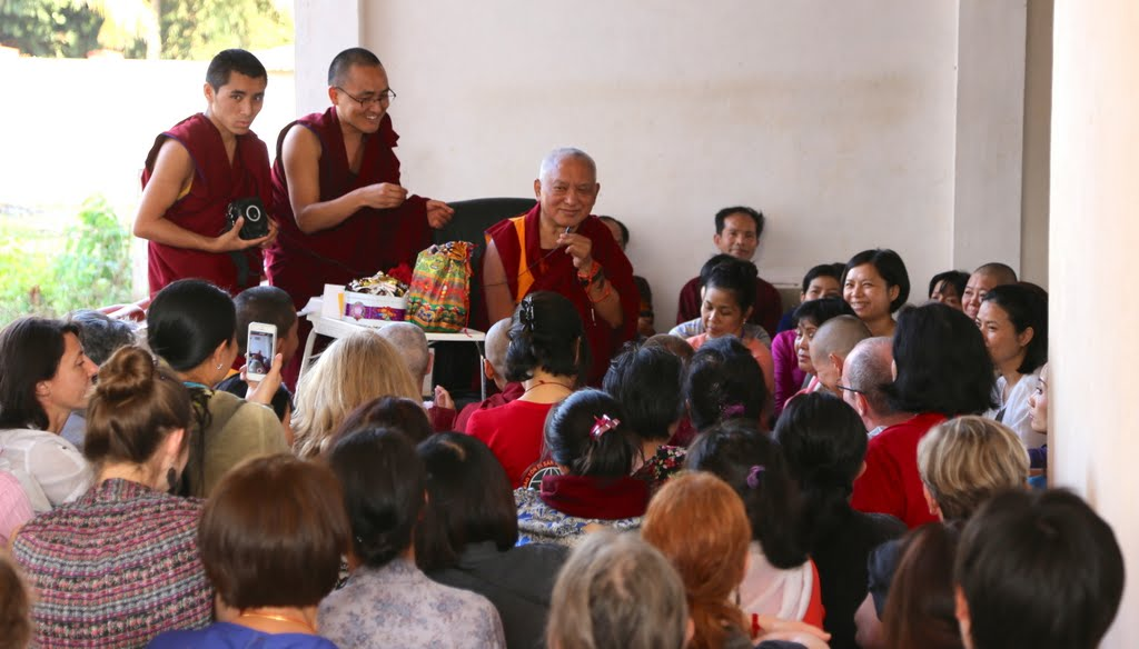 Lama Zopa Rinpoche offers advice to a group of Vietnamese students during a break at the Jangchup Lamrim teachings at Gaden Monastery, December 2014. Photo by Ven. Roger Kunsang.