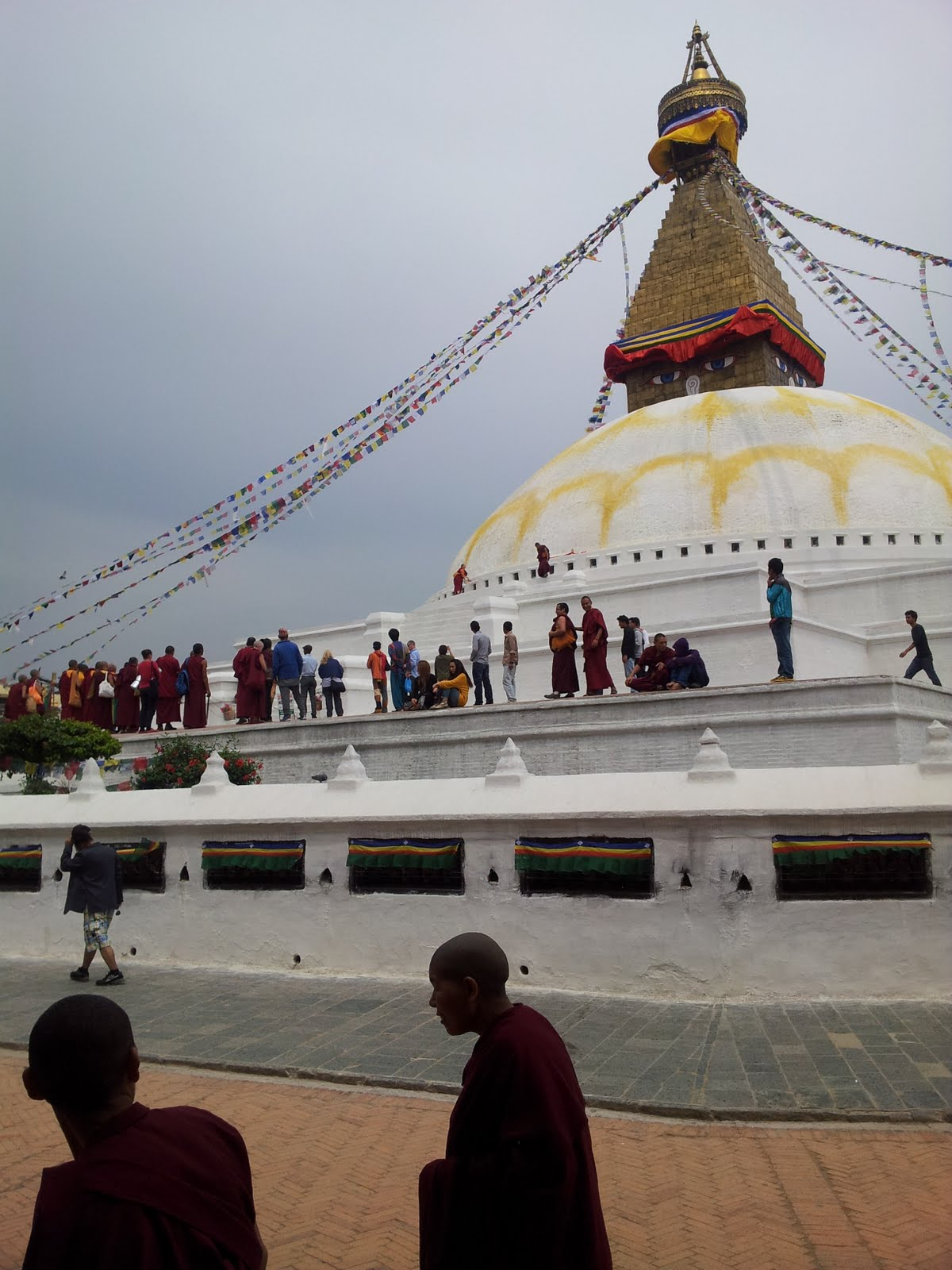 Rinpoche and Khadro-la offered special prayers and 4 gold plated dharmachakras to the Boudha stupa in the 4 directions. 21 April 2013. Photo by Ven. Roger Kunsang.