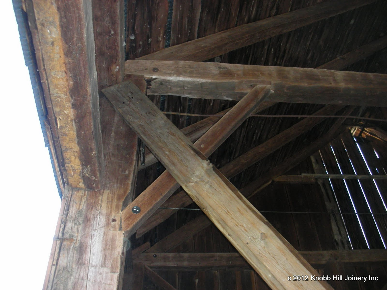 The only tie beam brace that was in place when we first saw the barn clearly did not fit.  The rest of the tie braces were missing altogether.