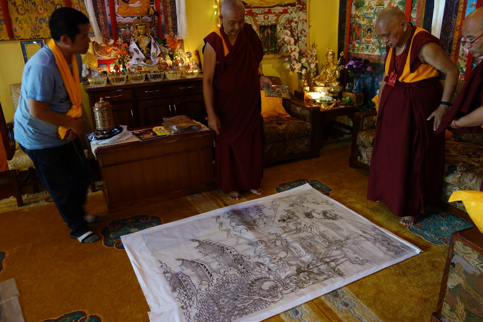 Rinpoche checking the art of thangkas he is having done: The Eight Fearless Taras and The Twenty-one Taras. Kopan Monastery, August 10, 2013 Photo: Ven. Roger Kunsang.