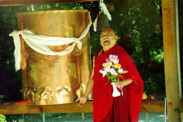 Lama Zopa Rinpoche at Land of Medicine Buddha prayer wheel.