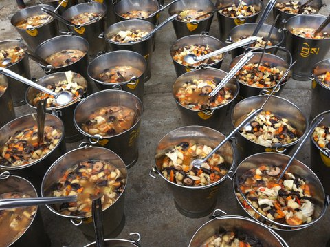 Buckets of soup about to be offered to the thousands of monks