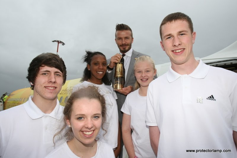 (left to right) Dennis Coles from Scotland, Georgia Higgs from Cornwall, Sakinah Muhammad from London, Chloe Brown from Northern Ireland and Sean White from Swansea with David Beckham as he hold the Olympic flame before the flight back to the UK.