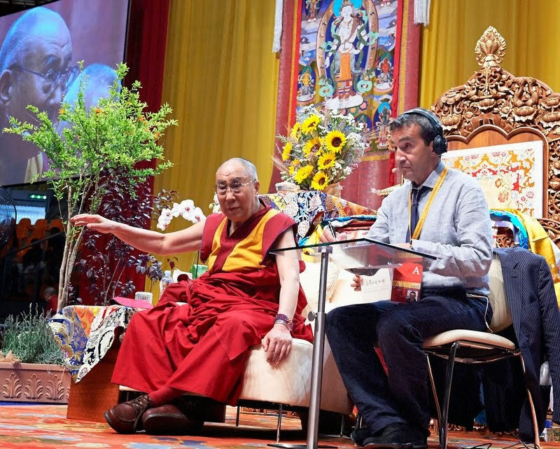 His Holiness the Dalai Lama teaching with Fabrizio Pallotti providing interpretation, Livorno, June 15, 2014. Photo by Olivier Adam.