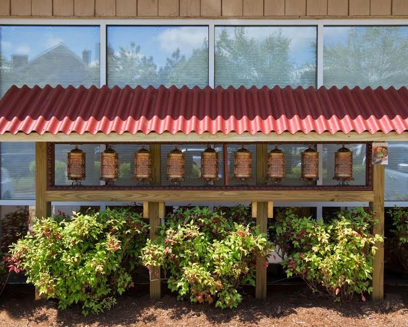 Prayer wheels at Kadampa Center, Raleigh, North Carolina, US, May 3, 2014. Photo by David Strevel.