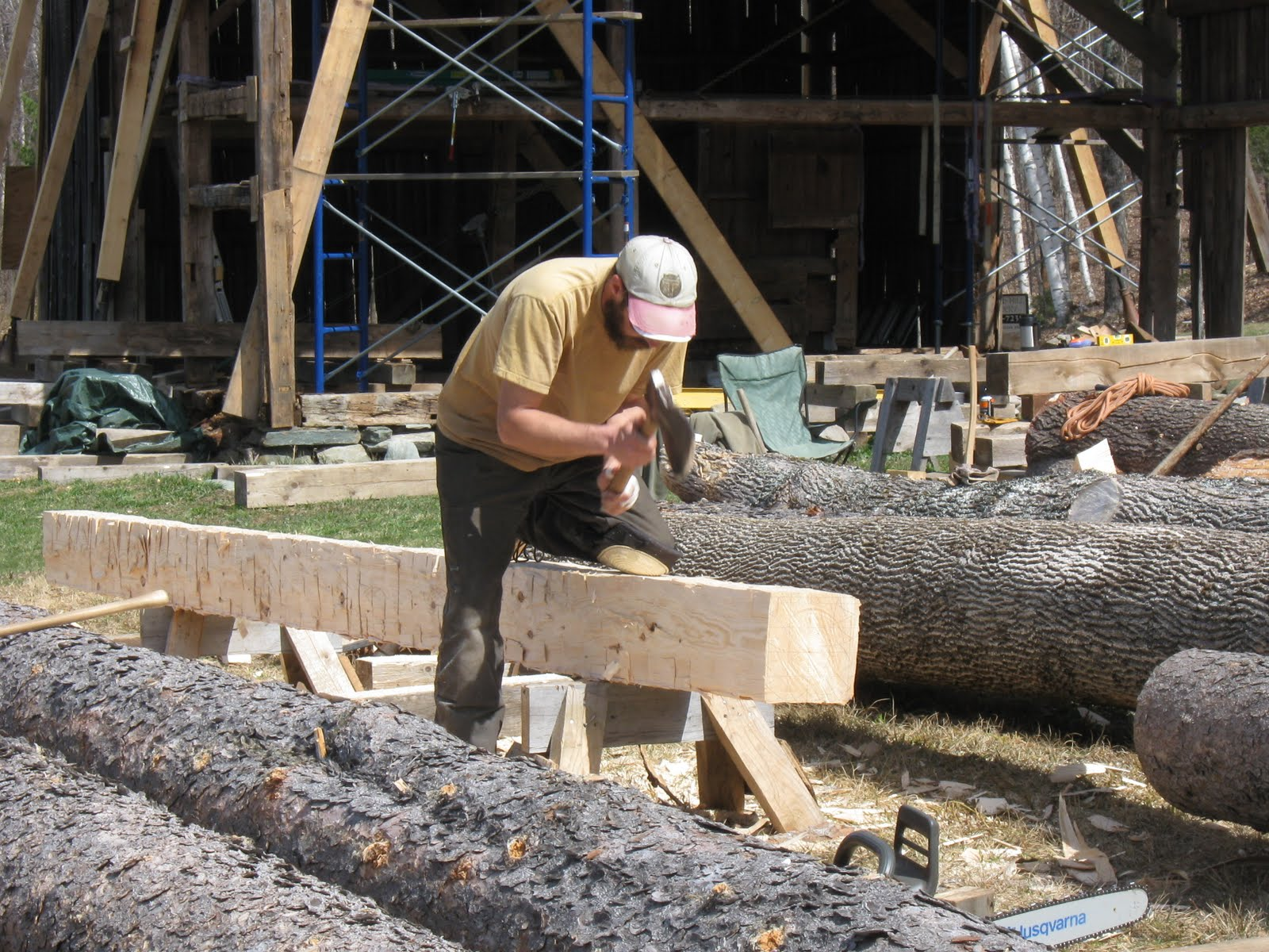 Michael hews the new post timber.
