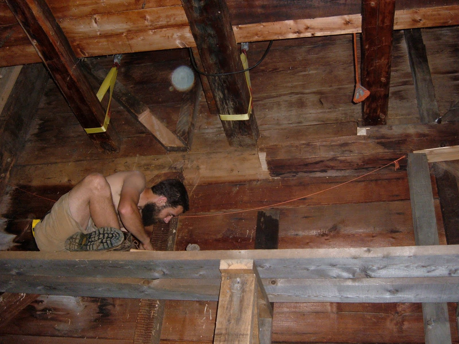 One floor below the girts that had rolled, another girt had significant rot.  The floor joists were suspended while the rotten portion of the girt was repaired.