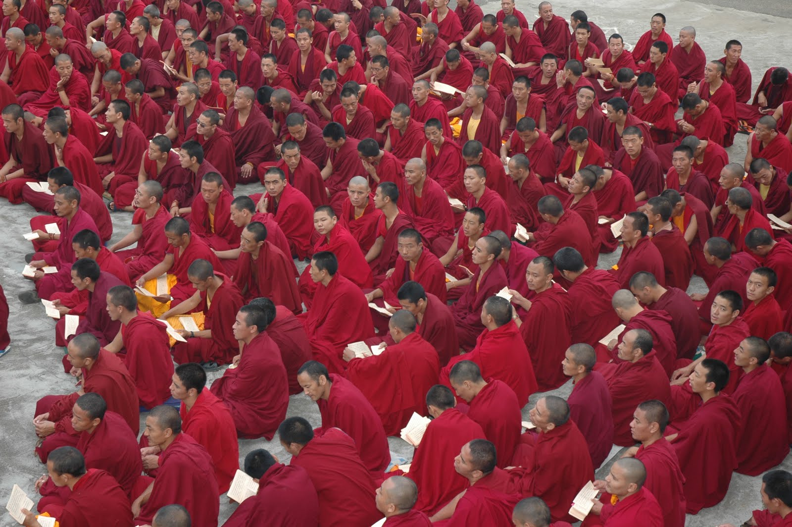 Monks doing puja and prayers in the courtyard of Sera Je Monastery