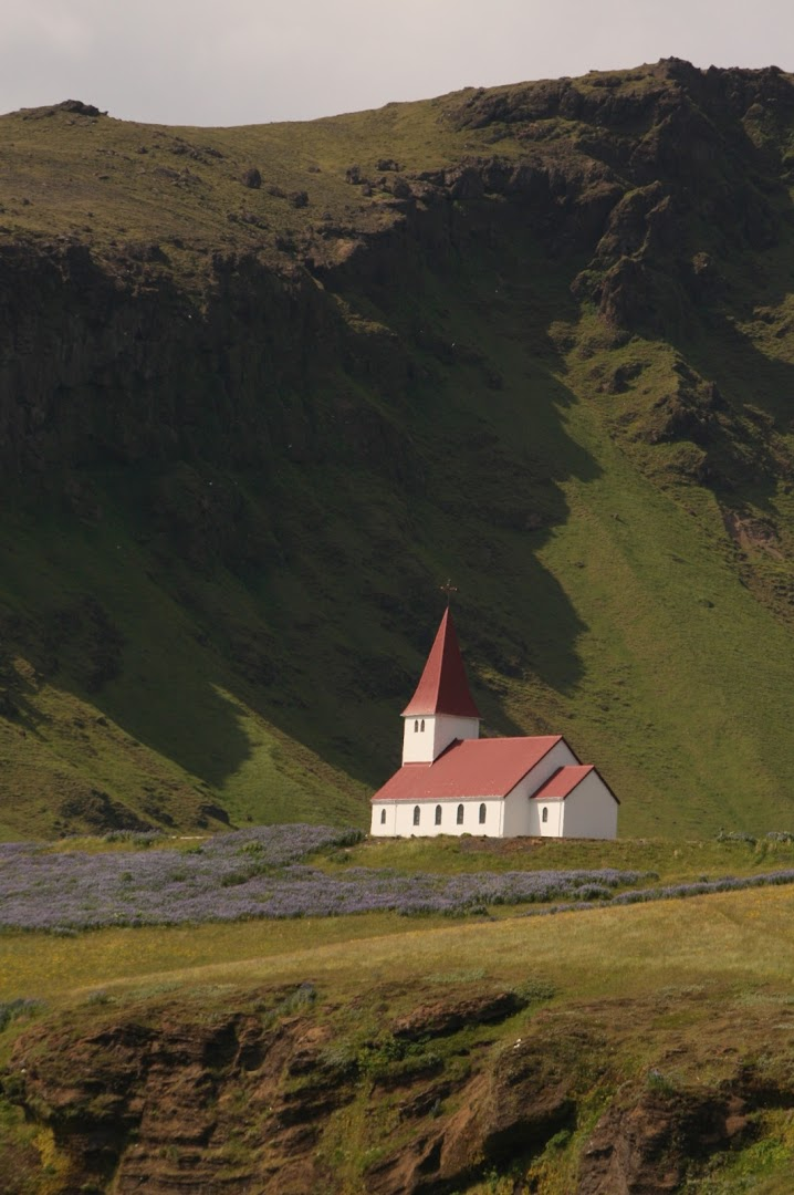 The church of Vik is above the town
