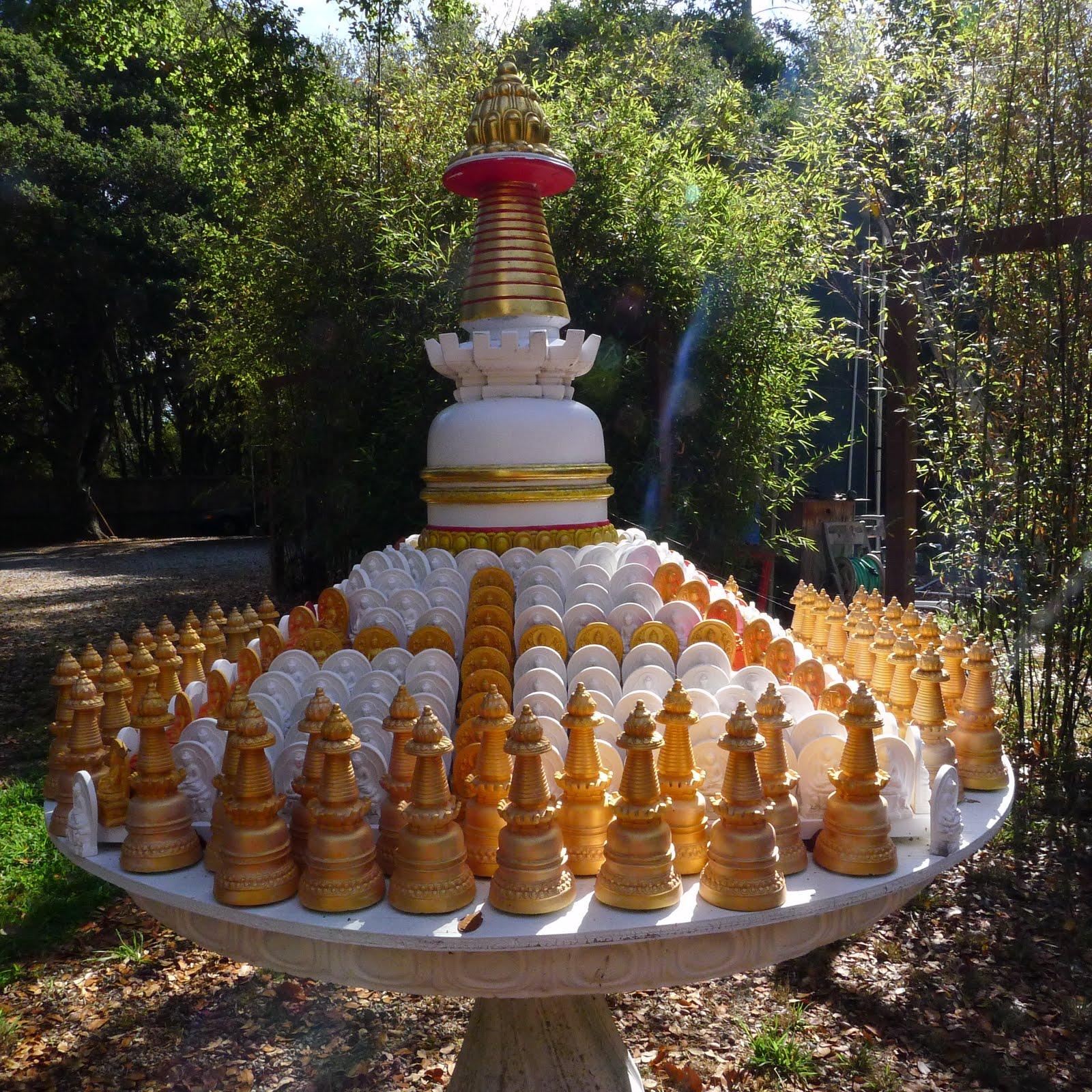 Tables of small Kadampa stupas to circumambulate at Kachoe Dechen Ling, Aptos, CA, USA.