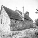 St Mary's Church. The church exterior from the north-east showing the flint-faced chancel and nave and timber bell turret, as well as some Norman survivals such as windows. Copyright © Oxfordshire County Council Photographic Archive. Reproduced with the kind permission of Oxfordshire Studies. This photograph may be purchased from their Heritage Search web site at http://www.oxfordshire.gov.uk/heritagesearch