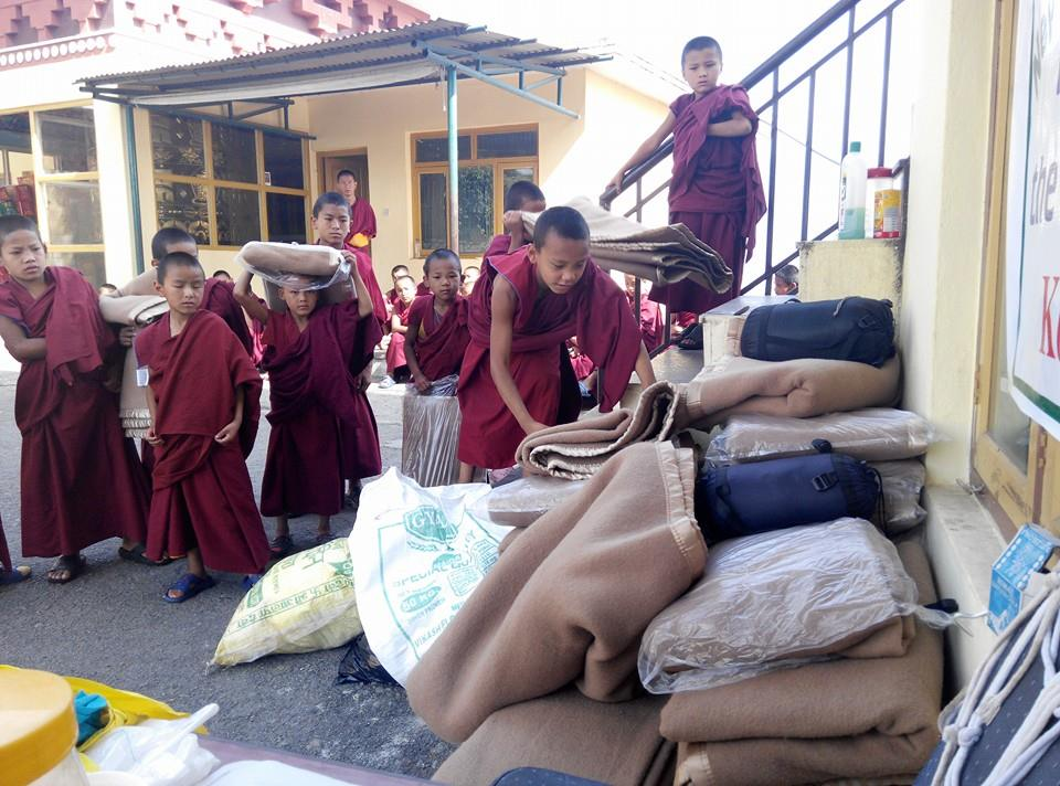 Young Kopan monks donating blankets to earthquake victims, May 1, 2015.