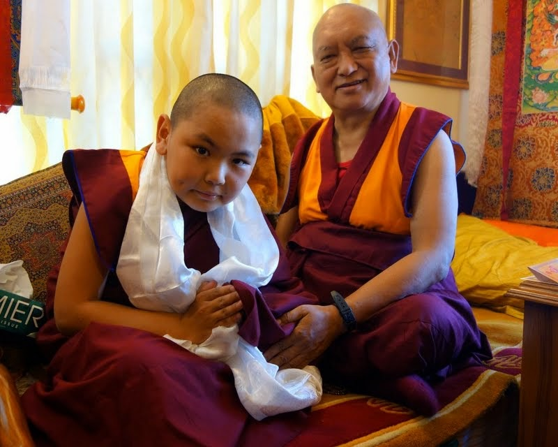 Tenzin Phuntsok Rinpoche greeting Lama Zopa Rinpoche at Sera Monastery, India, December 2013. Photo by Ven. Roger Kunsang.
